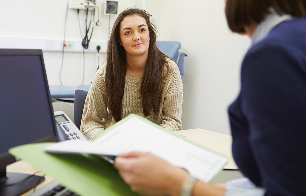 young woman discussing test results with doctor
