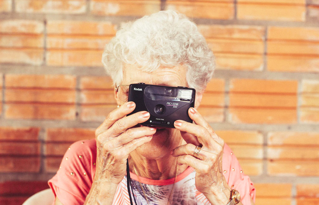 older woman with camera